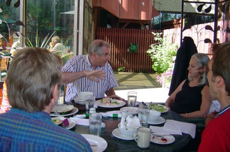 Arthur Kroeger having a lively lunch discussion with UAP Acquisitions Editor Michael Luski, Designer Alan Brownoff, and Director Linda Cameron.