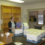 Cathie and Katy working on the board room