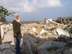 Ghada on the ruins of her best friend's home