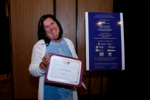 Norma Dunning with award certificate.